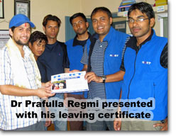 Dr Prafulla Regmi being presented with his leaving certificate